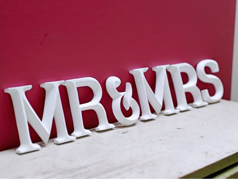 Mr & Mrs sign Cox & Cox