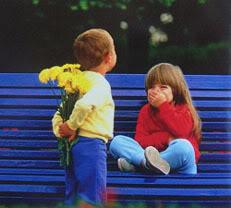Boy_girl_bench_flowers